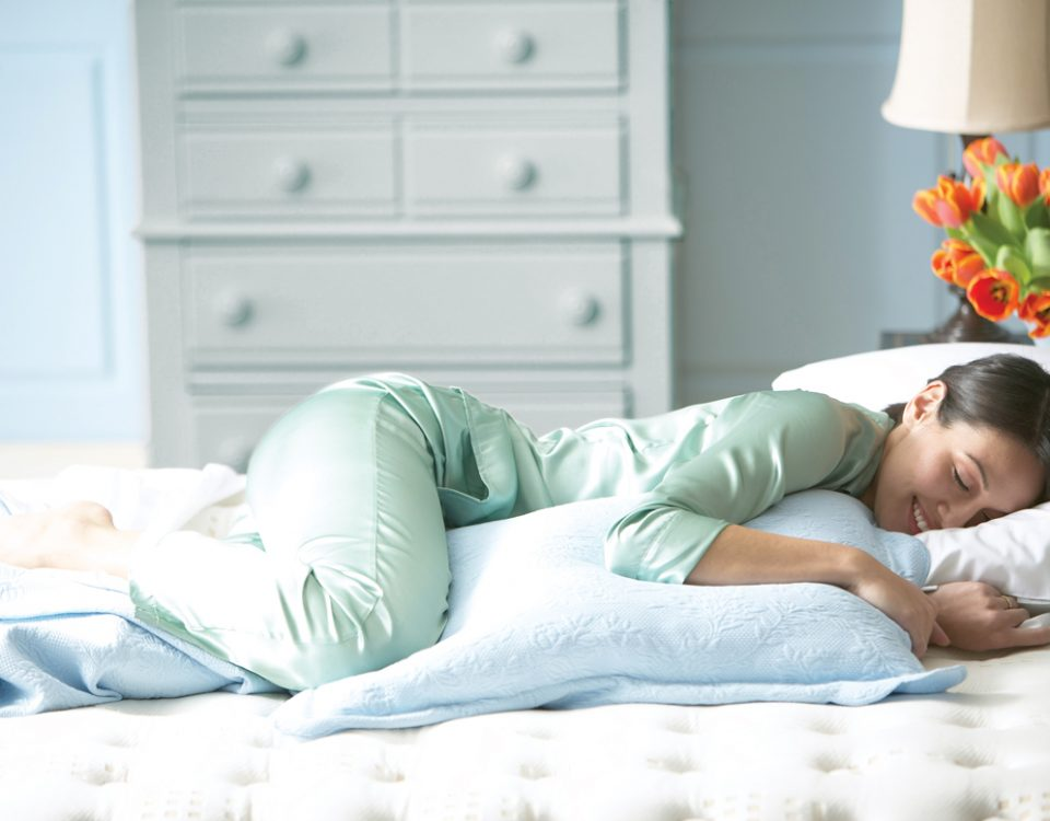 woman lying on sealy pillow and mattress