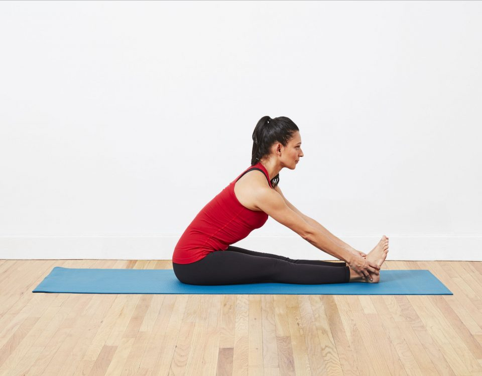woman doing stretching on yoga mat for better sleep